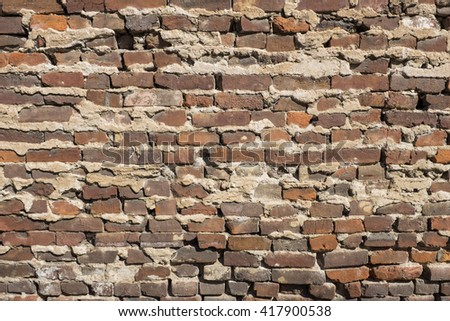 Old historic brick wall - stock photo