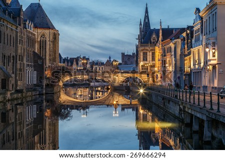 Old historic center of city of Ghent at Belgium in blue hour, view on the Sint Michiels bridge - stock photo