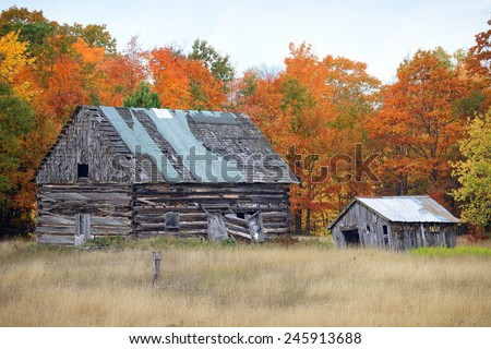 Old historic log buildings, Autumn in Michigan's Upper Peninsula - stock photo