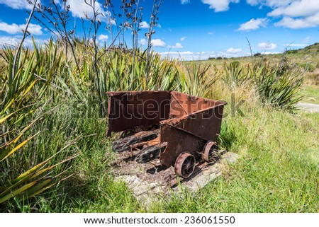 Old historic mine trolley from the Victorian period, abandoned and decaying, New Zealand - stock photo