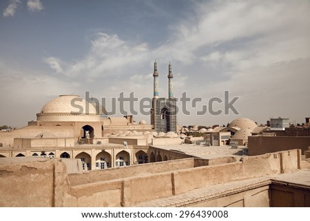 Old historical city of Yazd with traditional clay and brick buildings in its skyline. - stock photo