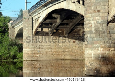 Old historical stone bridge on river. Summer morning. Vologda city, Russia
