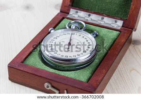 Old historical stopwatch in a wooden box, retro style. - stock photo