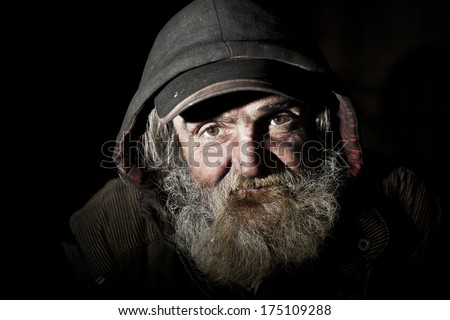 Old homeless man on the city - stock photo