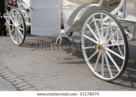 old horse - drawn buggies trot around Krakow - stock photo
