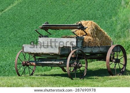 Old horse-drawn wagon with bales of hay, Palouse, Washington - stock photo