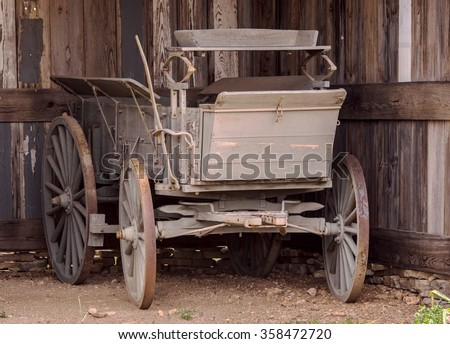 Old horse driven carriage in a barn
