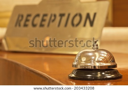 old hotel bell on a wood stand - stock photo