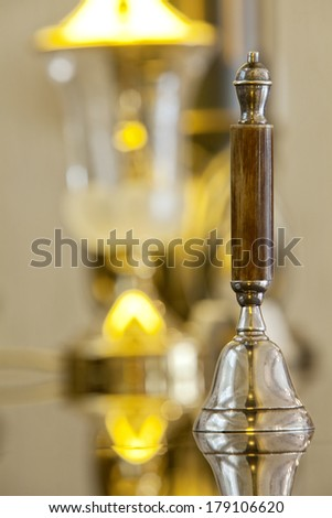 old hotel bell with a lamp in background - stock photo