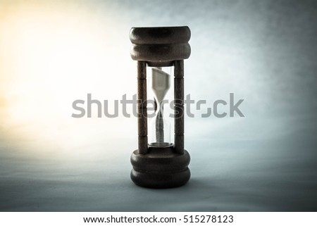 Old hourglass and light,Time concept