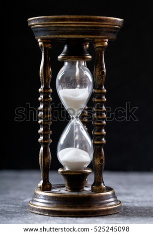 old hourglass on dark background