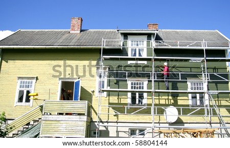 Old house being painted - stock photo