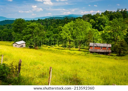 Old house in a field in the Potomac Highlands of West Virginia. - stock photo