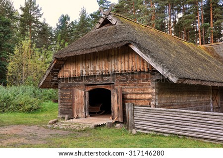 Old house in forest. Open-air ethnography museum near Riga, Latvia. - stock photo