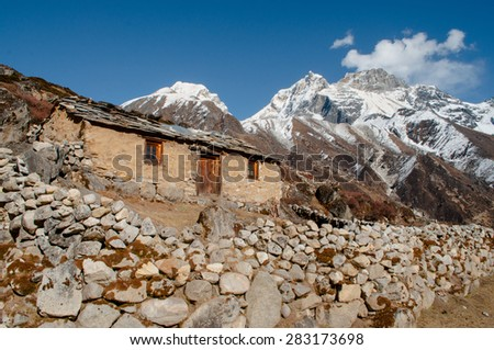 Old house in mountains in Himalayas on the way to Everest base camp in Sagarmatha National Park, Nepal  - stock photo