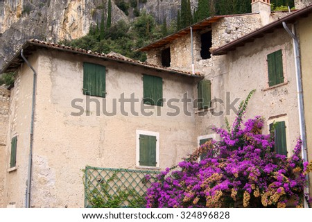 Old house in the middle of the mountains             - stock photo