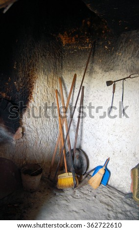 old house interior with used objects and kitchenware - stock photo