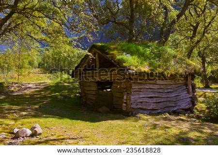 Old house near Briksdal glacier - nature and travel background - stock photo