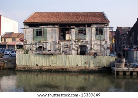 Old house on the bank of river in Melaka - stock photo