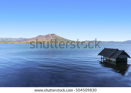 old house sunk in batur lake with batur mount background