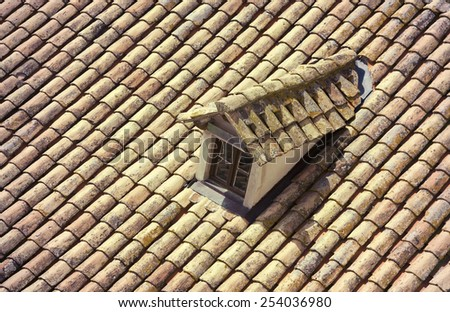 Old house top with traditional roof and a little window - stock photo