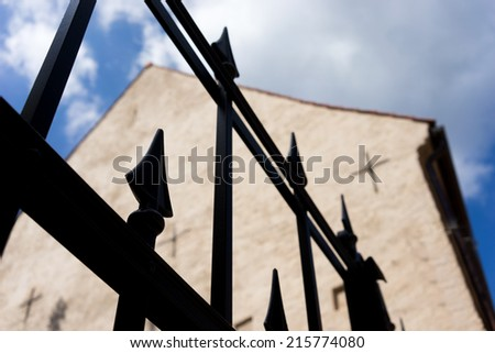 Old house with a pointed metal fence. Riga, Vecriga, Latvia - stock photo