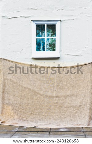 Old house with protective sheets for re-plastering - stock photo