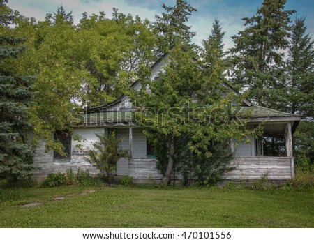 Attractive Old House With Veranda On Abandoned Farm In Manitoba Canada