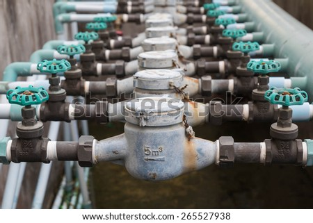 Old household water pipe valve,Front view. - stock photo