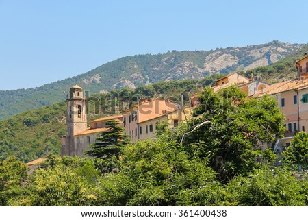 Old houses and bell tower on the hill on Elba Island, Marciana, Italy - stock photo