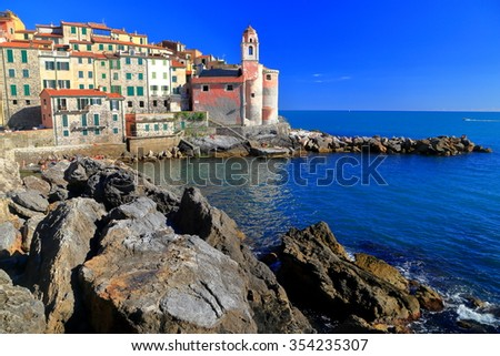 Old houses and church by the sea in Tellaro, La Spezia, Italy