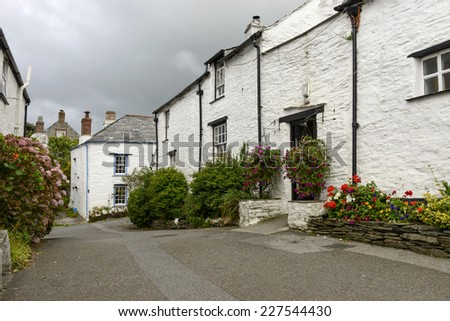 old houses at Boscastle, Cornwall, foreshortening of ancient village on the north coast of Cornwall, shot just before the storm begins  - stock photo