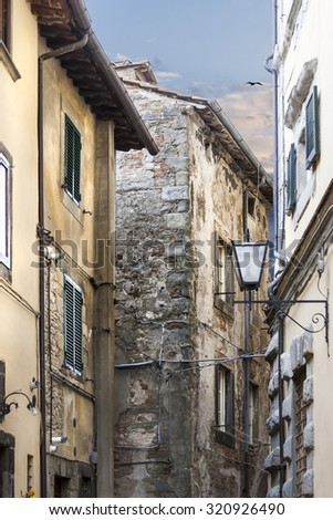 Old houses, narrow streets with peculiar mood in italy