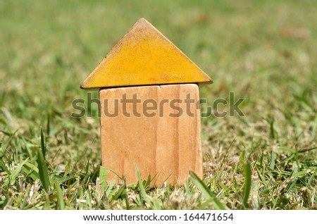 Old houses on green grass. Concept photo of Real estate market bubble , booming, money,price, grid, home, rent, house, housing, industry and subprime mortgage crisis. (Copy Space) - stock photo