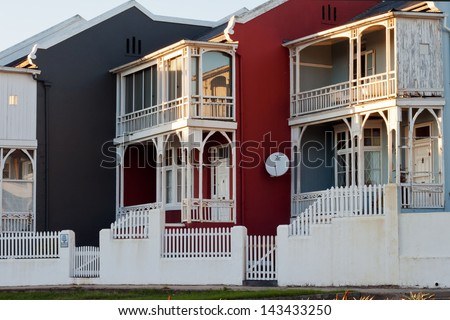 Old houses, renovated and brightly painted. Photographed in early morning sunlight. Port Elizabeth central ,South Africa.