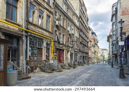 Old housing in decay in downtown Bucharest, Romania - stock photo