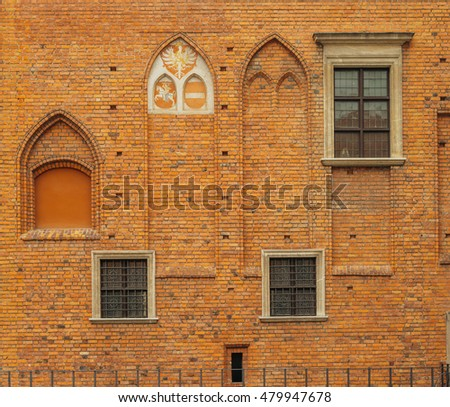 Old huge gothic building wall. Tall sealed windows. Brickwork. Historical city elements. Classic european architecture. Postcard concept. Travel inspiration. Luxury estate background. Vintage effect.
