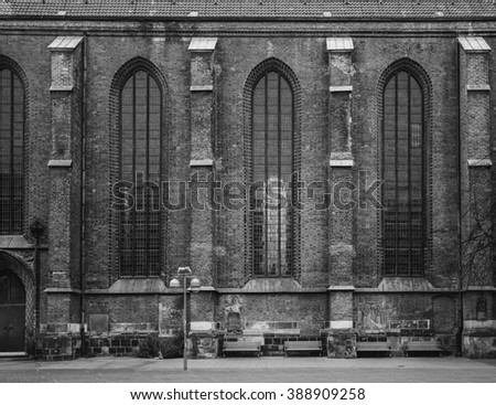 Old huge gothic building wall. Tall windows. Brickwork.   - stock photo