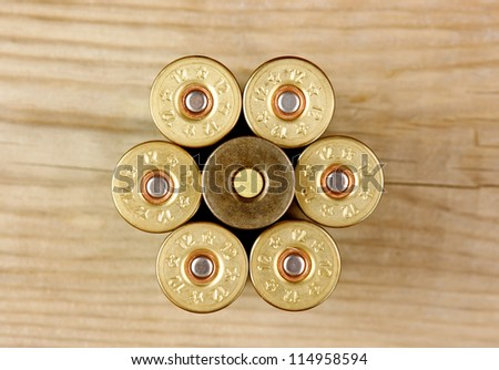 Old hunting cartridges on a wooden table - stock photo