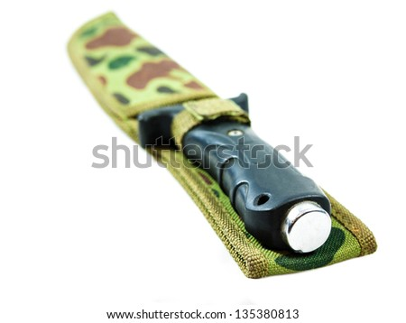 Old hunting knife in sheath on white background.