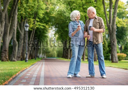 Old husband and wife walking in nature