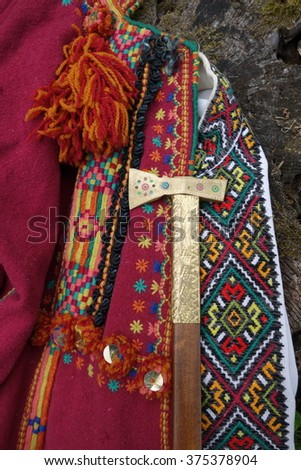 Old Hutsul clothes and a small ax