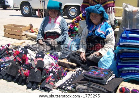 Old indian ladies are selling dolls of Comandante Marcos partisans. San Cristobal de Las Casas. Mexico - stock photo