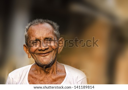 Old Indian Man portrait shot outside. - stock photo
