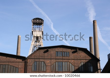 Old industrial building against blue sky