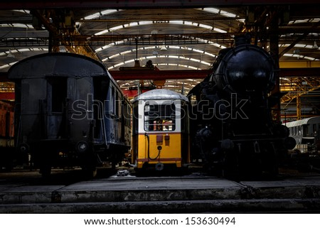 Old industrial locomotive in the garage abandoned - stock photo
