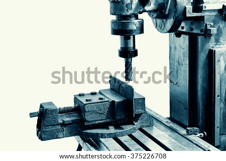 Old industrial milling machine on a white background - stock photo