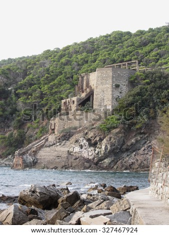 Old industrial structure used in the past to transport limestone from mine to the sea . Livorno, Tuscany, Italy - stock photo