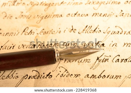old ink dip pen  isolated on white background - stock photo