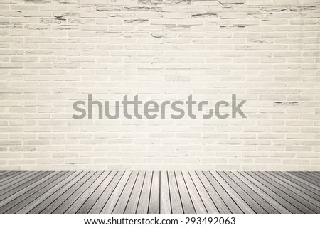 Old interior room with abstract light beige brick wall pattern and brown wood floor in warm gray tone